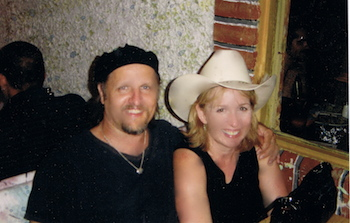a water-splotched photo of me with Jimmy LaFave, Austin 2004 (that's Tom Russell's cowboy hat on my head)